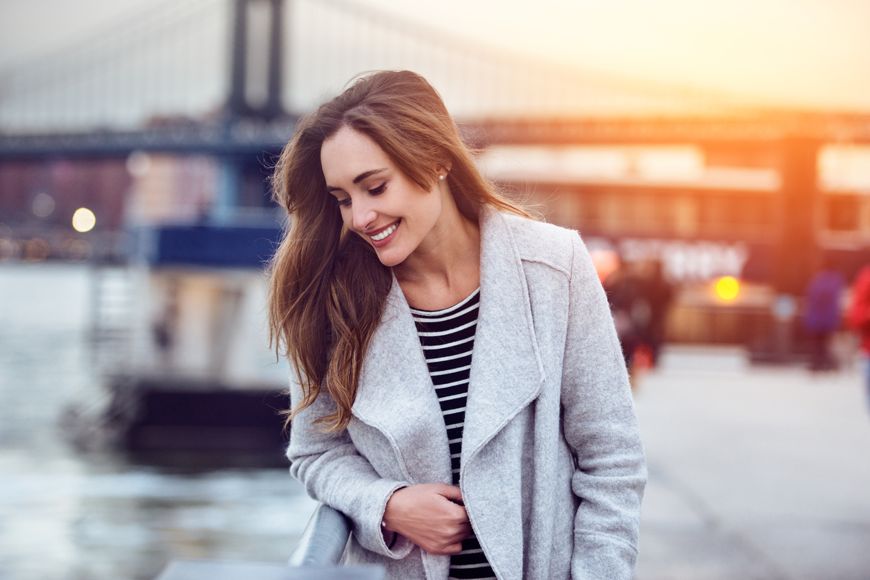 Beautiful happy woman walking and looking down