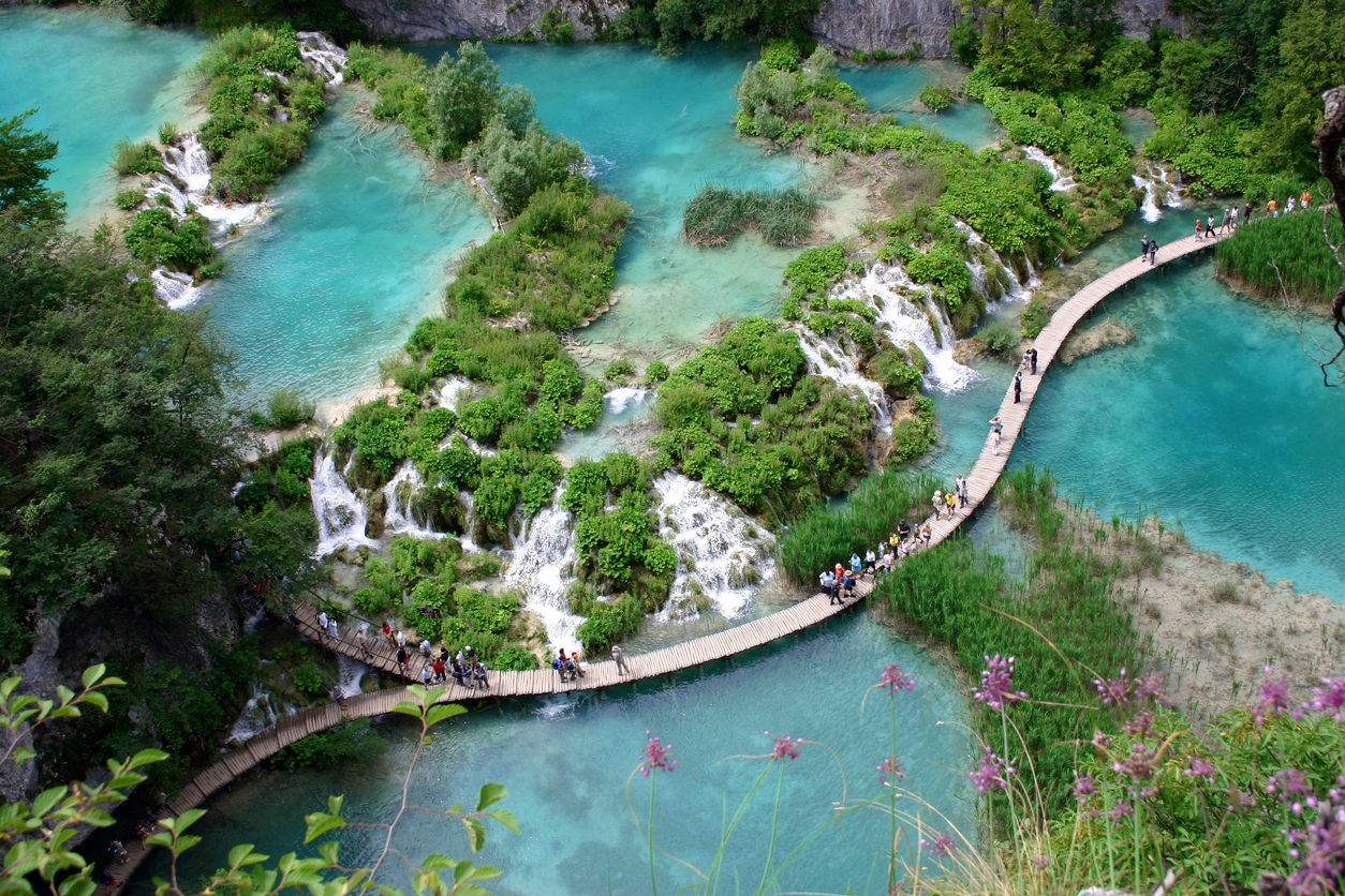 """""""People walking on a curvilinear footbridge over bright green water, Plitvice Lakes National Park (Croatia).View my Lightbox"""""""