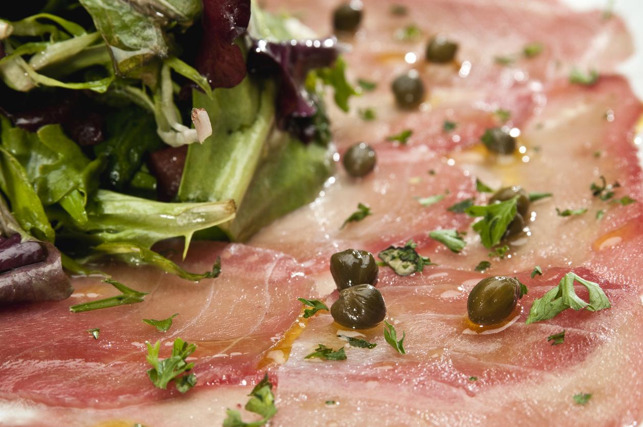 Thin sliced Tuna carpaccio close up