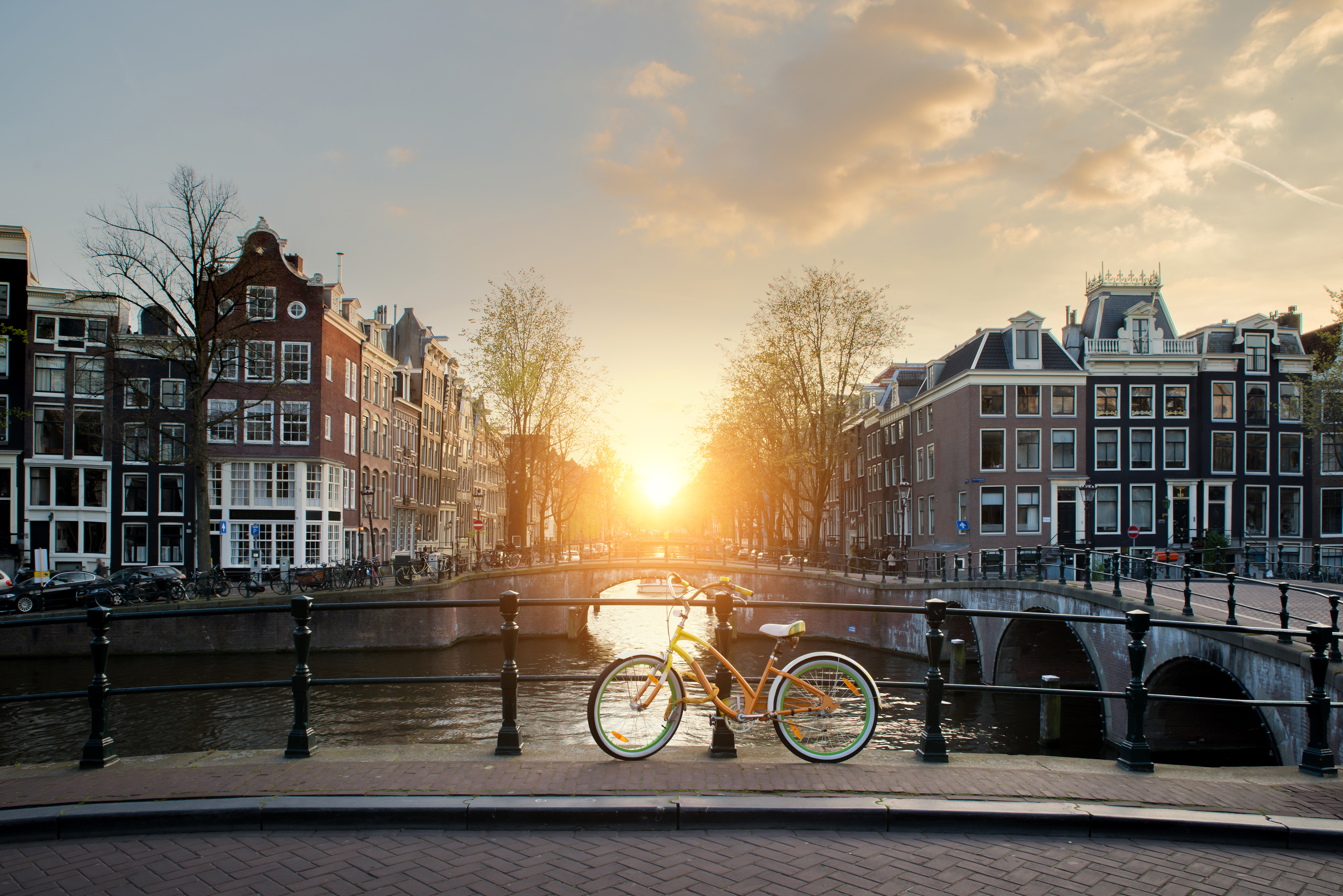 Bicycles lining a bridge over the canals of Amsterdam, Netherlands. Bicycle is major form of transportation in Amsterdam, Netherlands