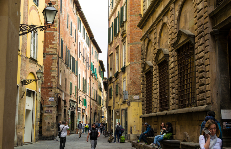 Tourists and locals on Via Cenami, Lucca, Italy
