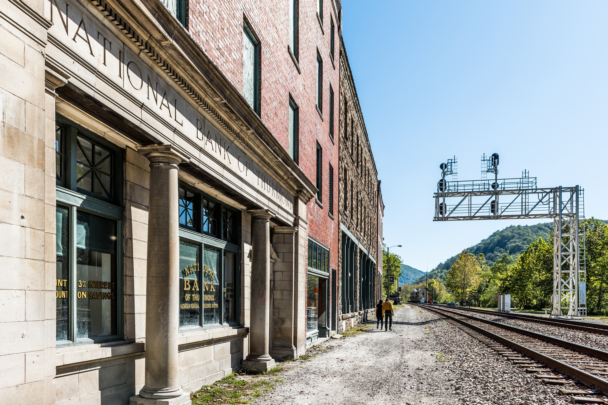 Abandoned closed retro vintage building with National Bank sign in West Virginia ghost town village, railroad
